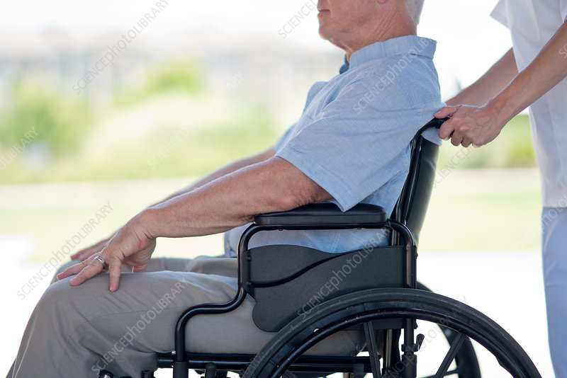 Senior man in wheelchair, side view