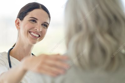 Female care worker smiling towards patient