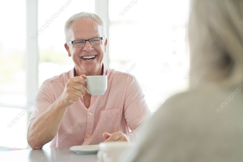 Senior man with cup of tea