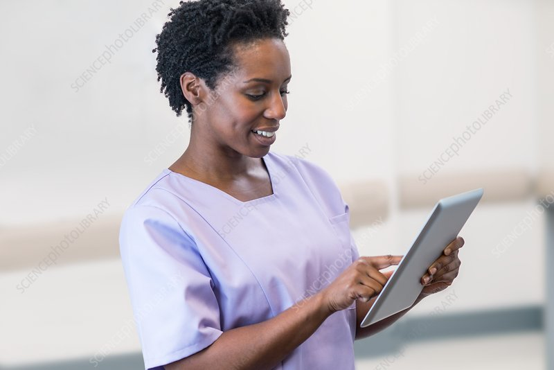 Woman nurse using tablet