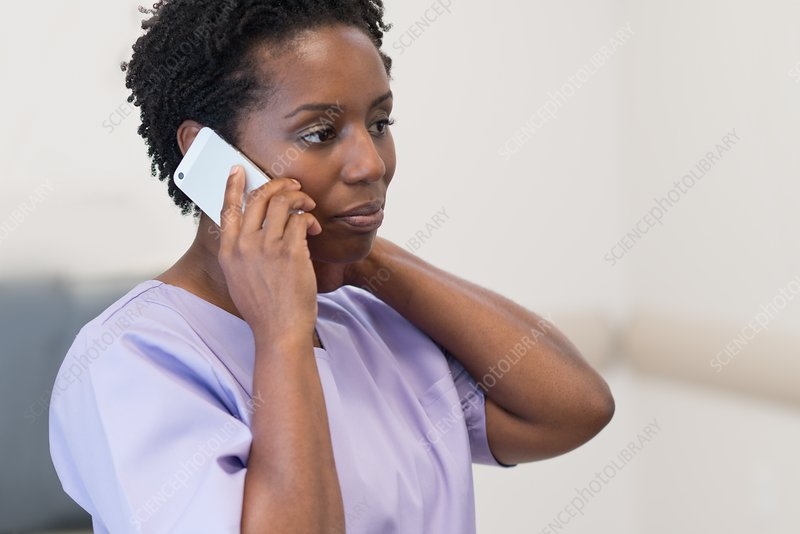 Woman nurse on cell phone