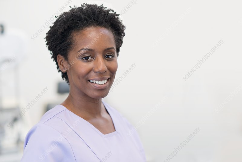 Woman nurse smiling towards camera