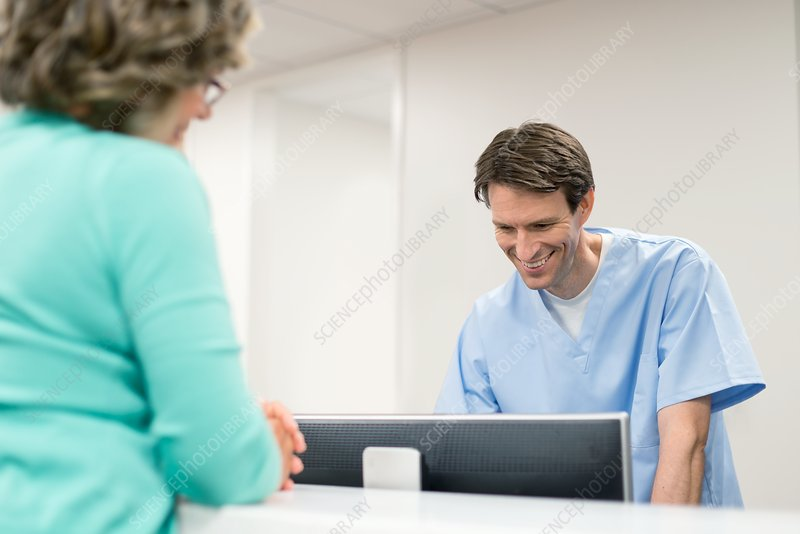 Man using computer with female patient