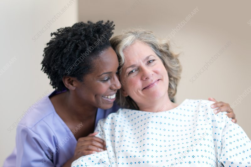 Nurse comforting female patient