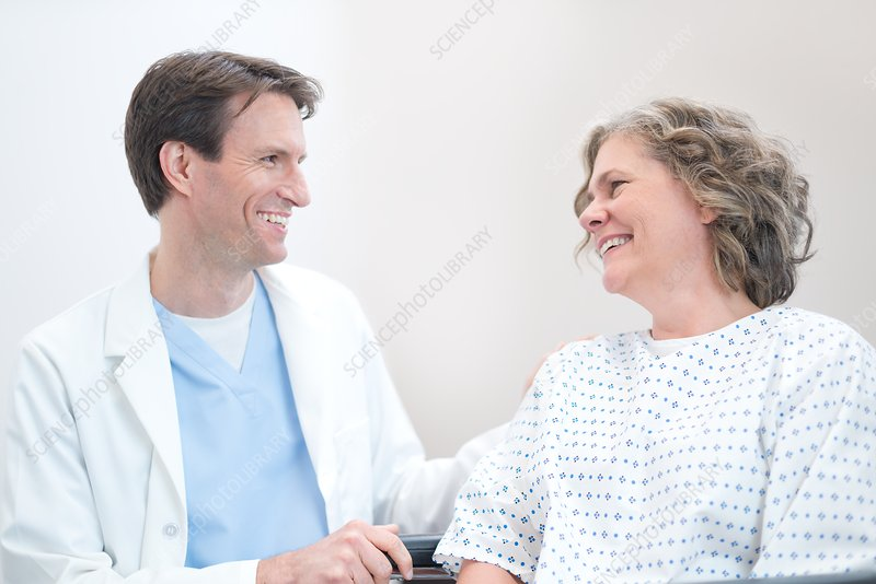 Doctor smiling at Woman patient