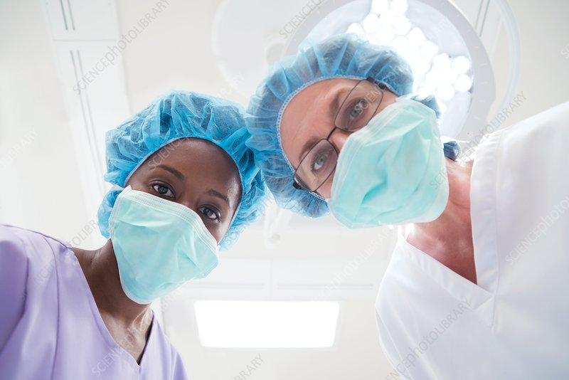 Surgeons looking towards camera