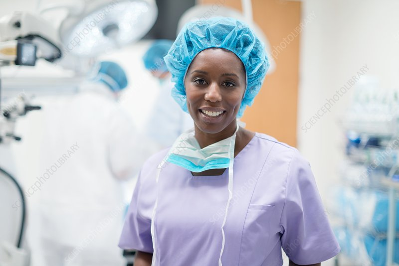 Female surgeon looking towards camera