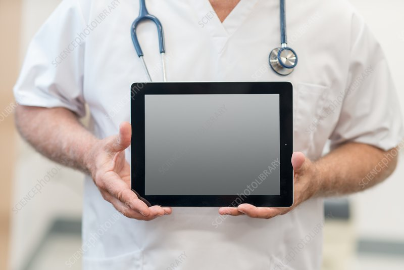 Male doctor with digital tablet