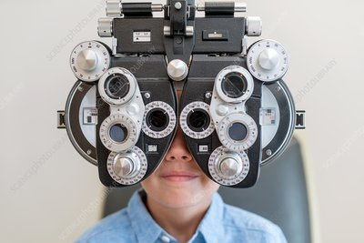 Boy having his eyes tested