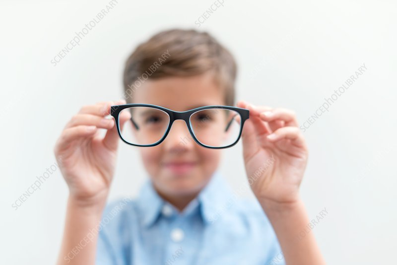 Boy holding glasses