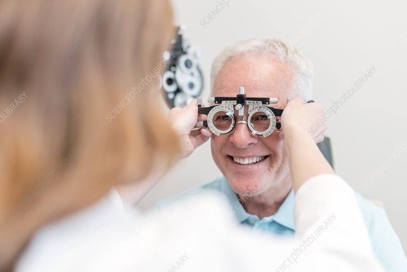 Optician testing man's eyesight