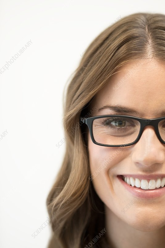 Mid adult woman wearing glasses