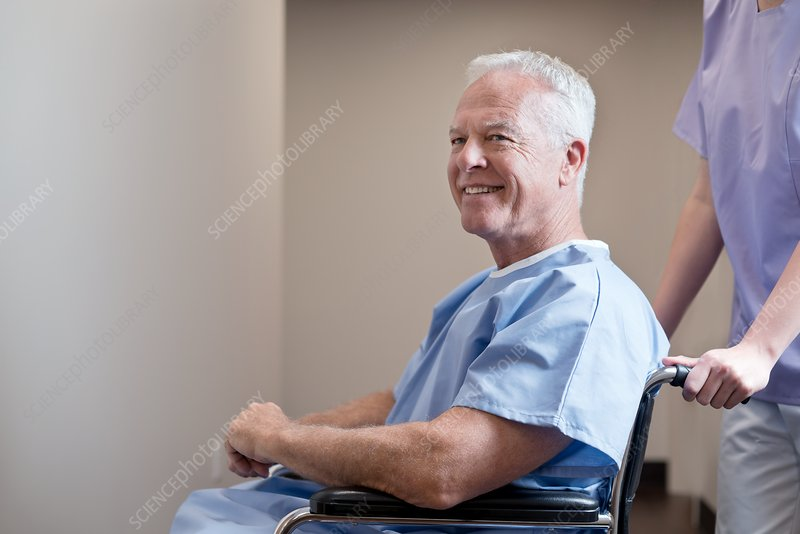 Man in hospital gown in wheelchair