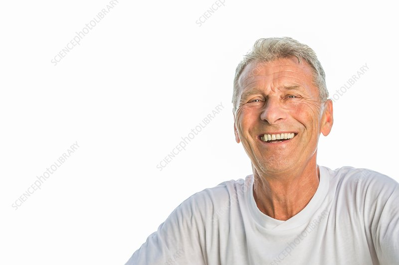 Man smiling against white background, portrait