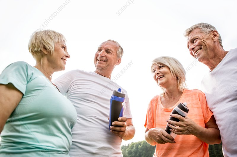 Four people outdoors with water bottles
