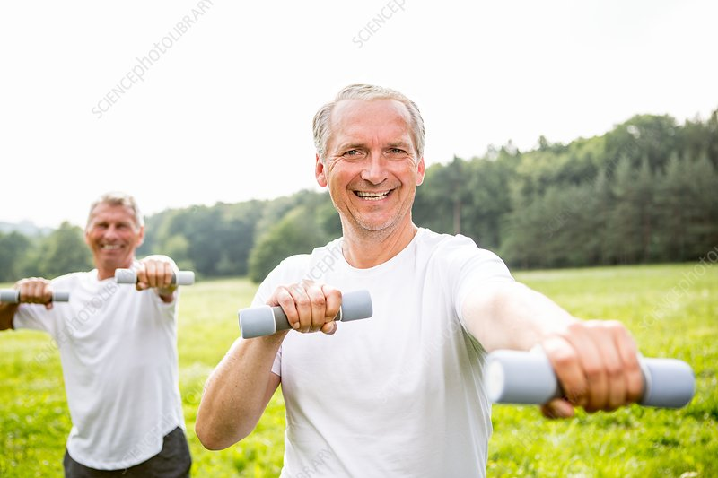 Two men exercising with hand weights
