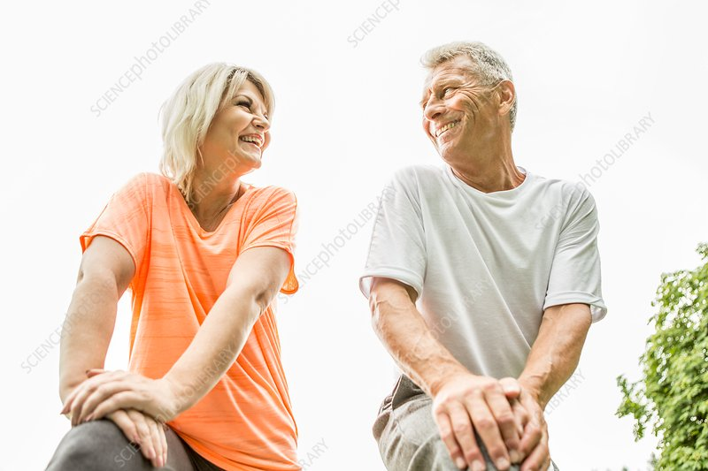 Couple smiling, low angle view