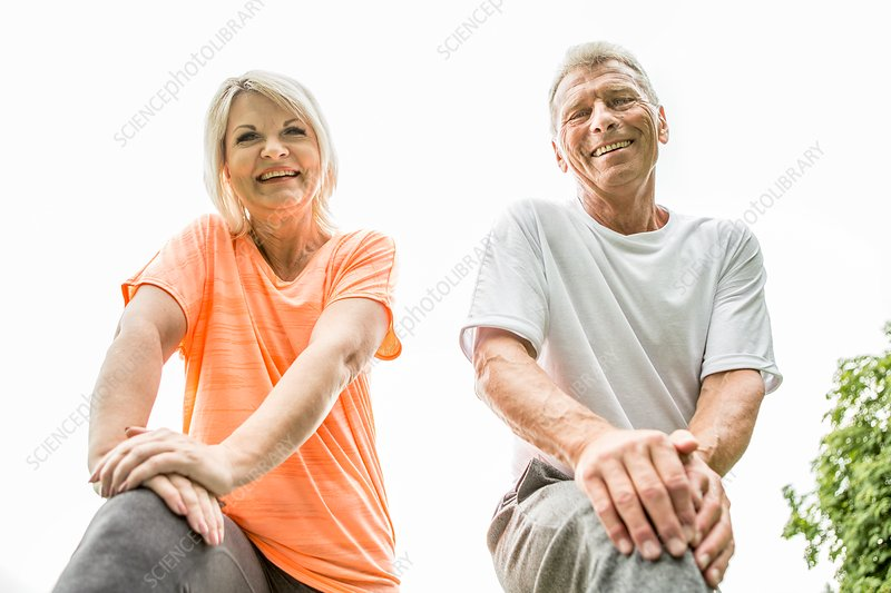 Couple smiling towards camera, low angle view