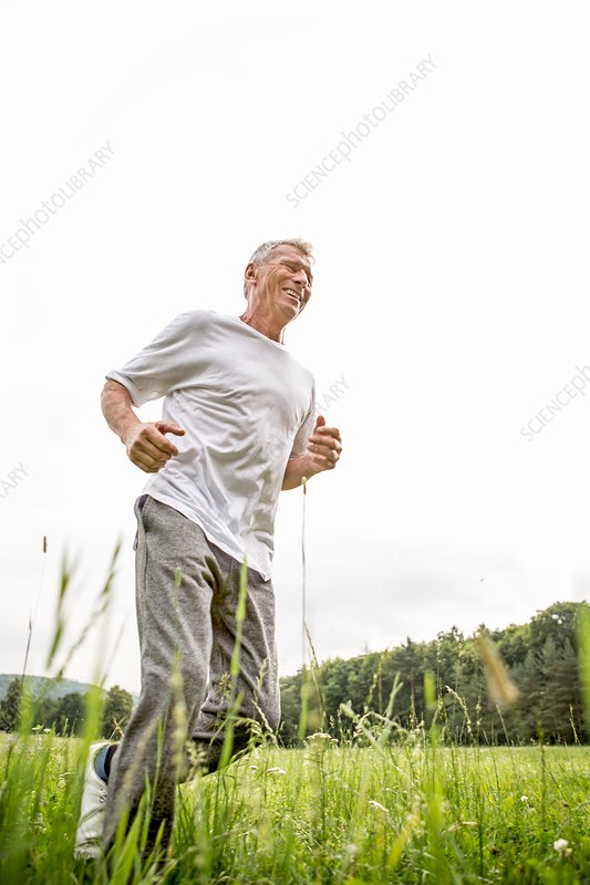 Man jogging in grass