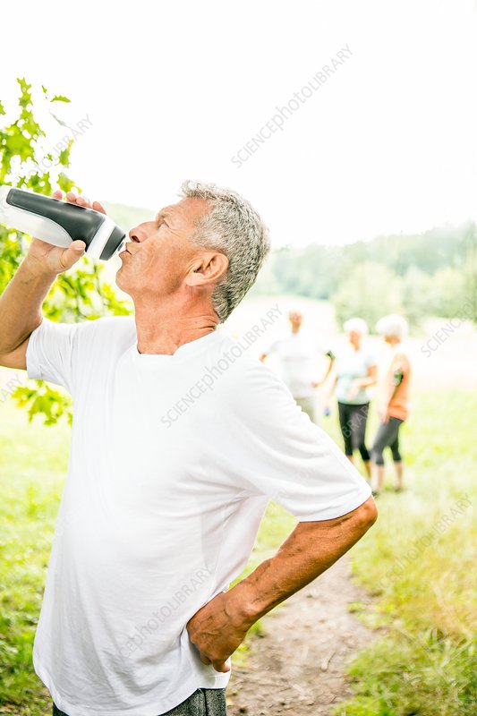 Man drinking water from sports bottle