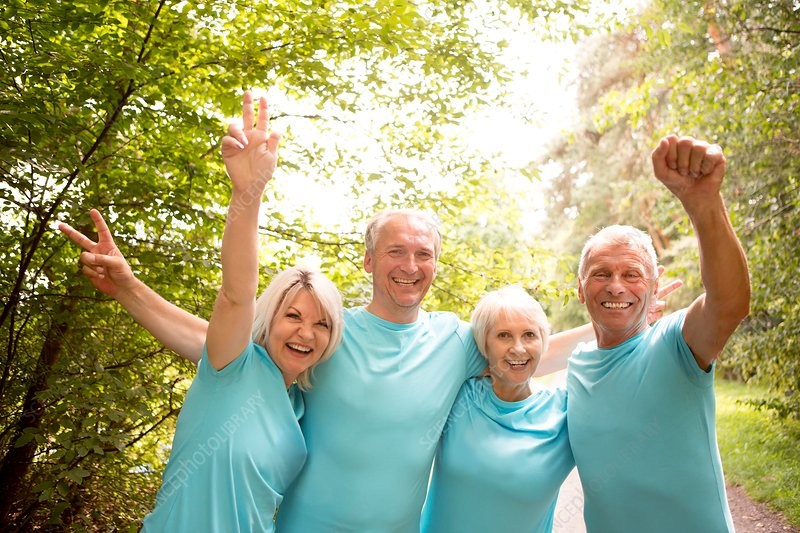 Four people in blue t-shirts, smiling