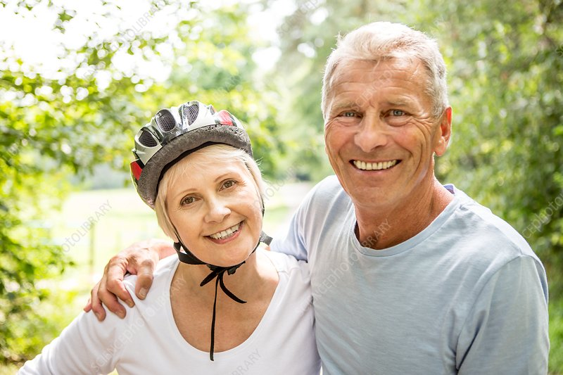 Mature woman wearing bicycle helmet