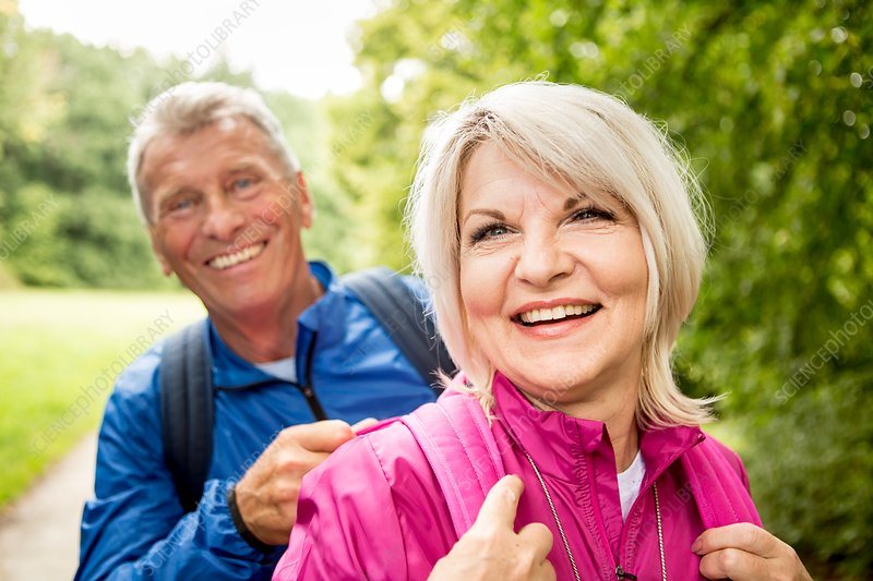 Senior couple on hike, smiling