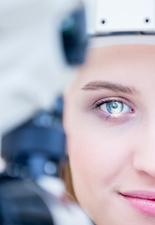 Eye examination of woman