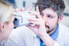 Female patient having eye examination