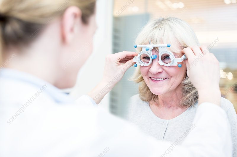 Optometrist performing eye test
