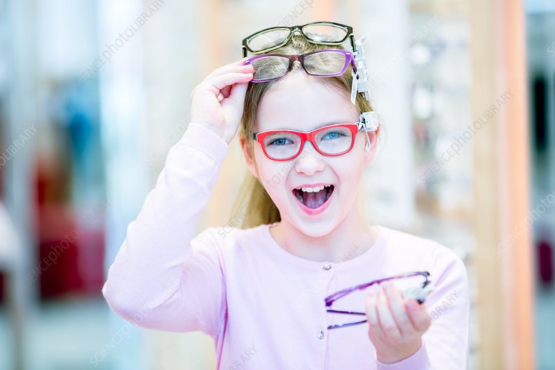 Girl trying on glasses