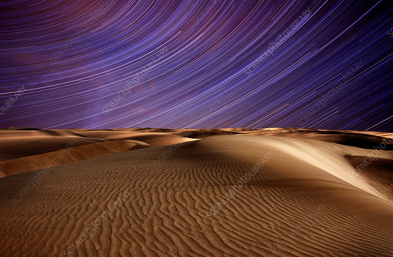 Star trails in the sky above the desert