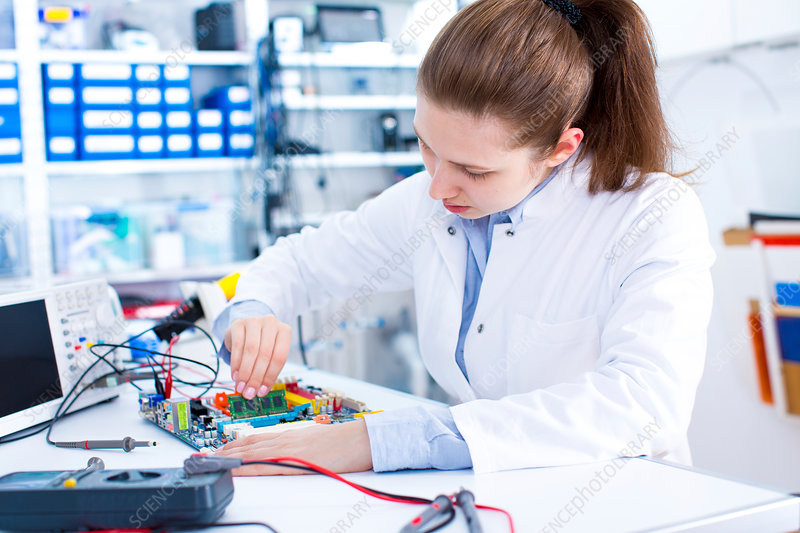 Female engineer working on a circuit board