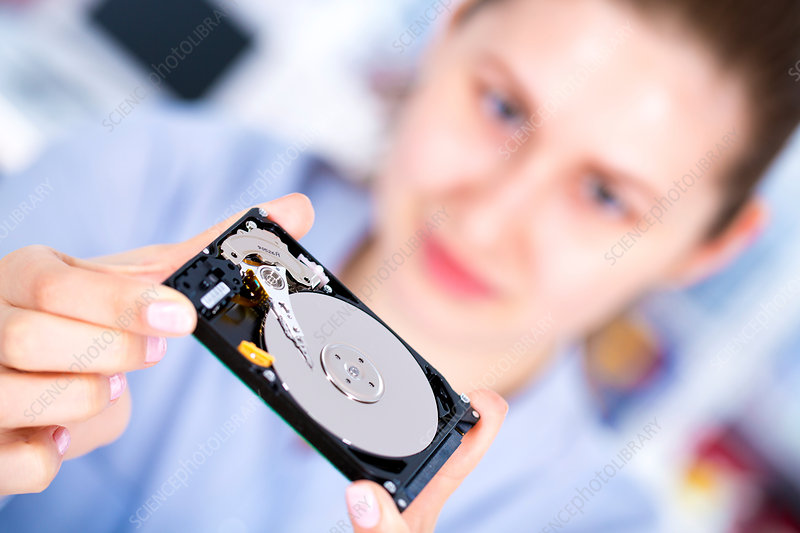 Female engineer holding hard disc drive