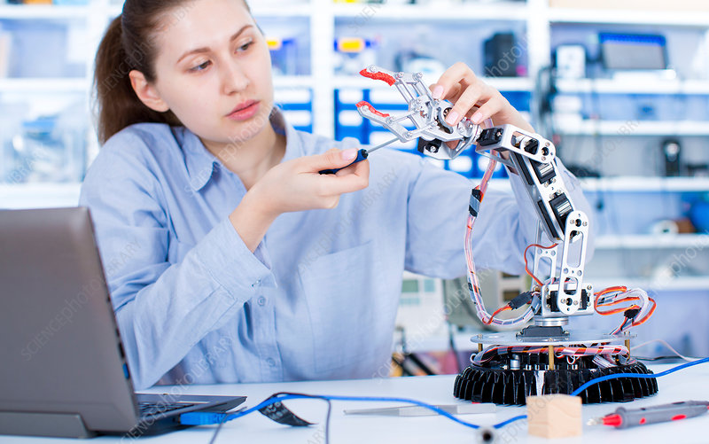 Female engineer working in a robotics laboratory