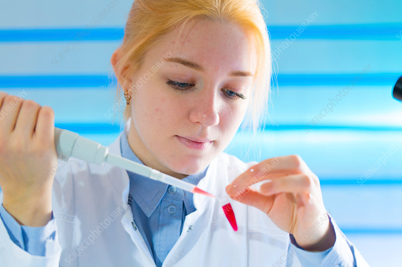 Scientist using pipette