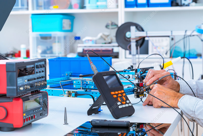 Person working in electronics laboratory