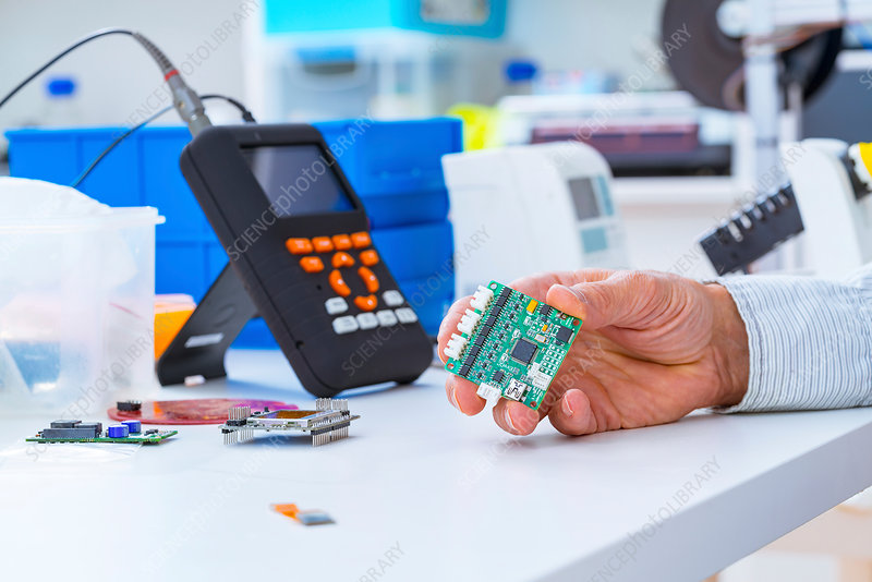 Person holding an electronic circuit board