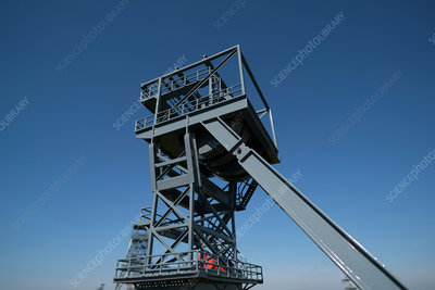Mine shaft lift against clear blue sky