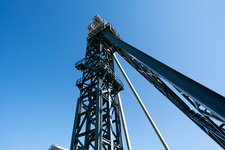 Drilling rig against a clear blue sky