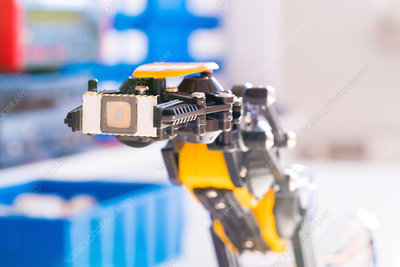 Robotic arm with microchip