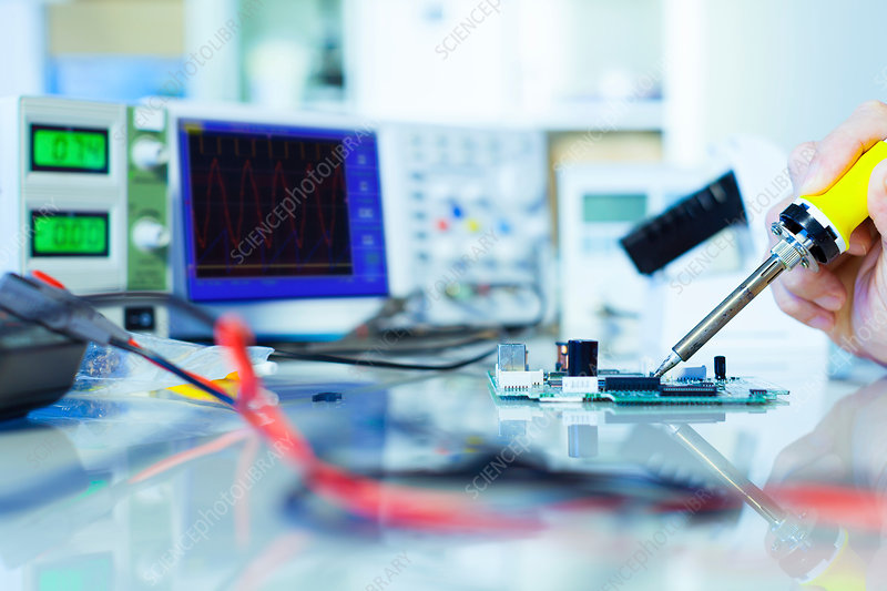 Person working in an electronics laboratory