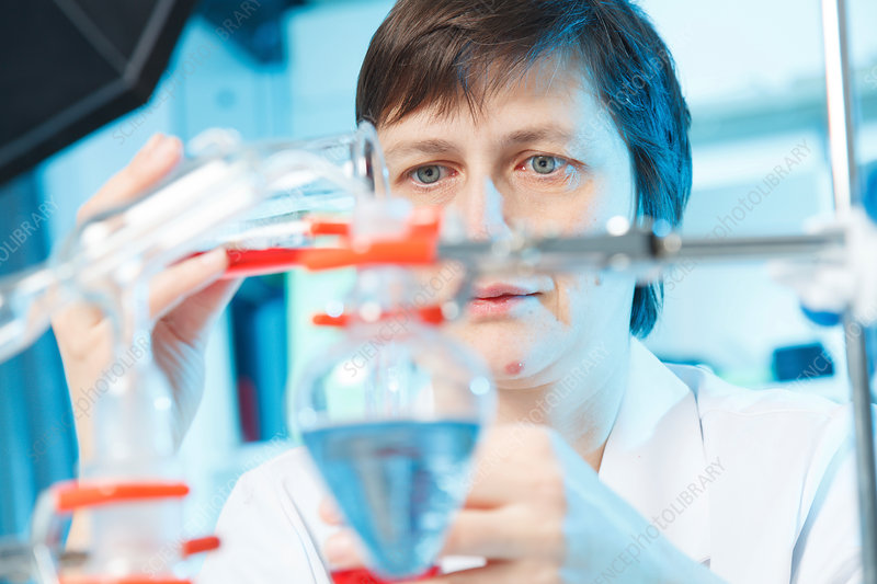 Woman doing experiment in chemical laboratory