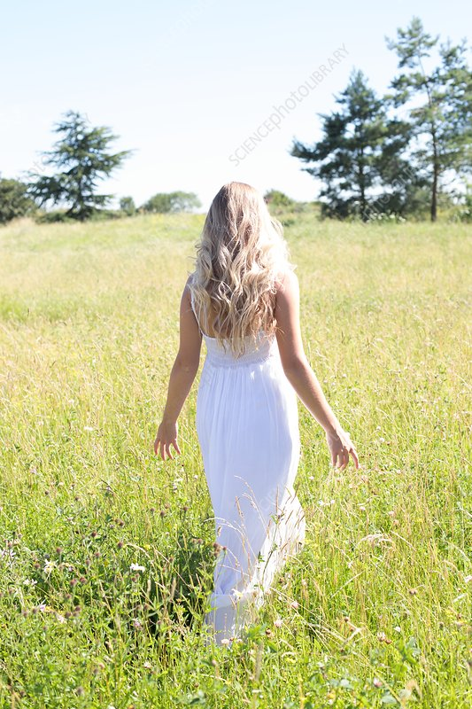 Woman walking in meadow