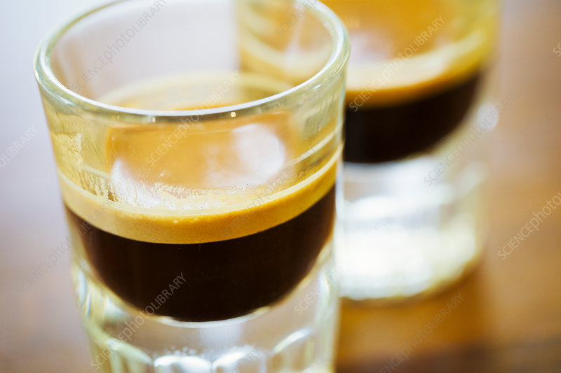 Close up of two espresso in shot glasses