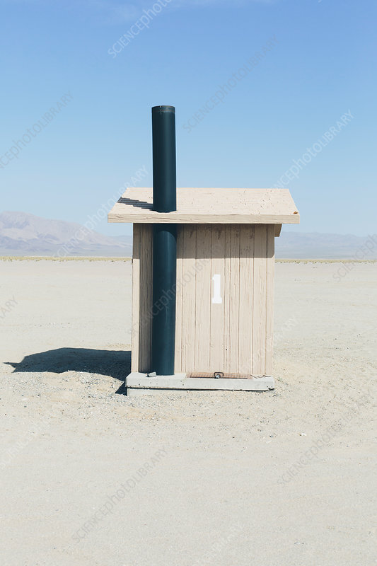 Restroom in an open space, a desert landscape