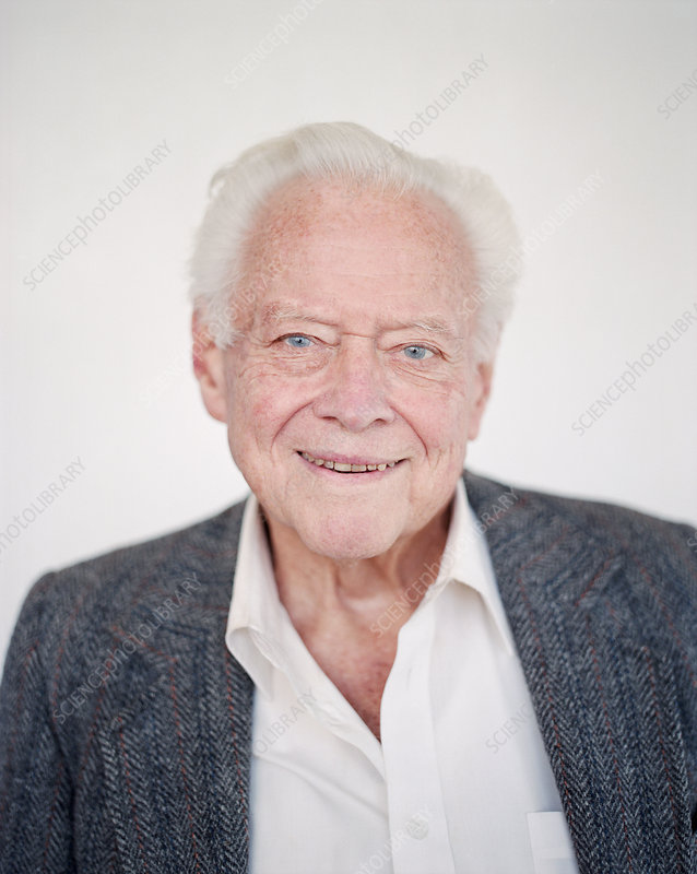 Elderly man with grey hair smiling