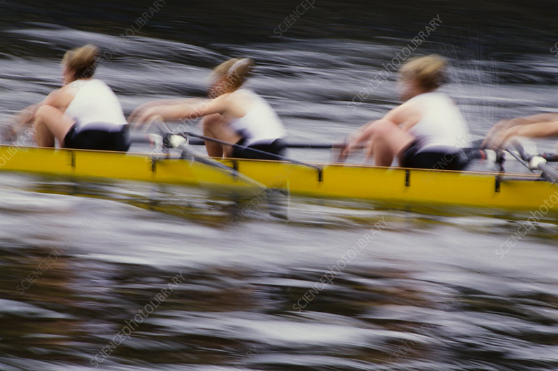 Female crew racers rowing in a racing scull boat