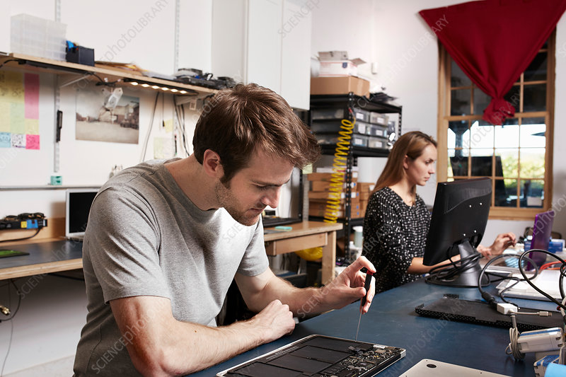 A young man and woman working in a technology lab