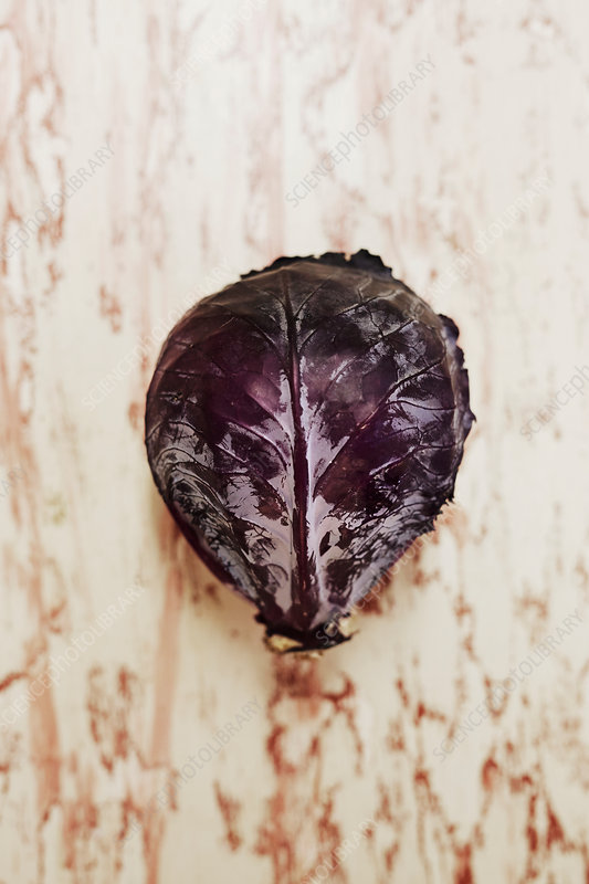 Head of red cabbage on a wooden surface, seen from above